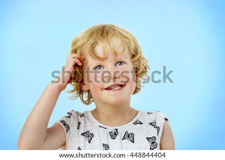 Portrait of a girl with blond hair and blue eyes - stock photo