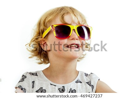 Portrait of a girl with blond hair and sunglasses
