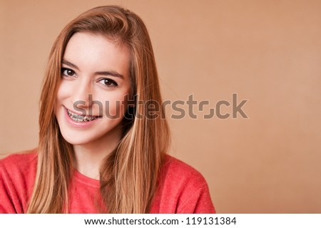 portrait of a girl with braces - stock photo