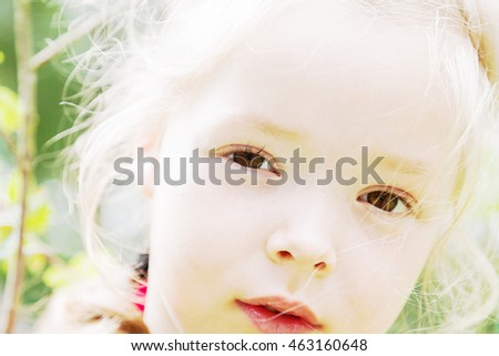 Portrait of a girl with brown eyes staring into the camera