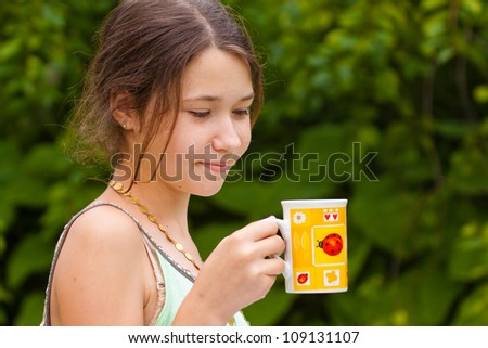 Portrait of a girl with cup of tea