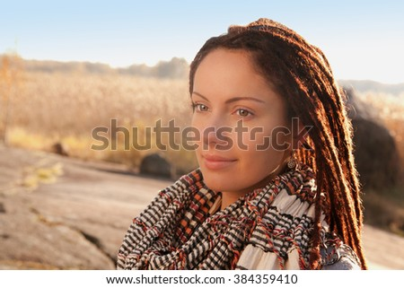 stock-photo-portrait-of-a-girl-with-dreadlocks-on-a-sunny-day-at ...