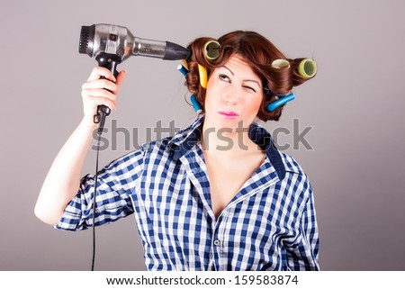 portrait of a girl with hair blower - stock photo