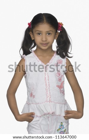 Portrait of a girl with hands in her pockets - stock photo