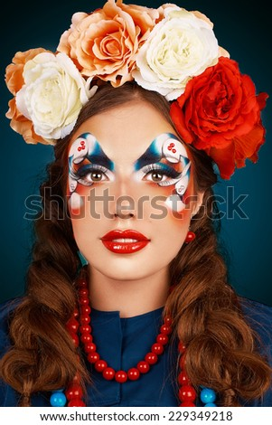 Portrait of a girl with makeup in the Russian style