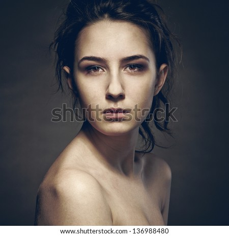 portrait of a girl with sad eyes - stock photo