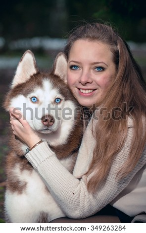 Portrait of a girl with Siberian husky - stock photo
