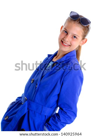 Portrait of a girl with sunglasses and wearing blue clothing. Isolated on white background