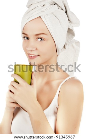 portrait of a girl with the glass, girl holding a drink, a beautiful young girl in a t-shirt with a towel on his head, isolated on white
