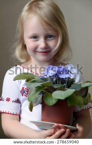 Portrait of a Girl with Violets - stock photo