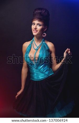 Portrait of a glamorous girl in an evening dress - stock photo