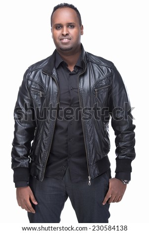 Portrait of a good looking happy young black man on the white background.