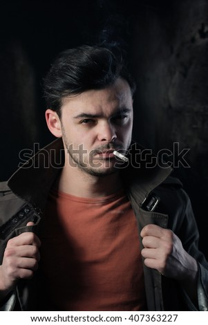 Portrait of a good looking man smoking a cigarette