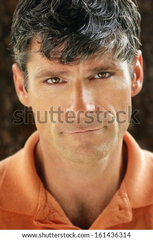 Portrait of a good looking serious mature man - stock photo