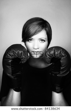 portrait of a good looking woman with boxing gloves