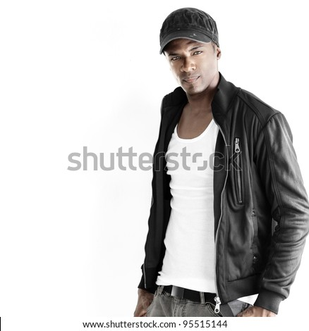 Portrait of a good looking young male model in trendy clothes against neutral white background with copyspace - stock photo