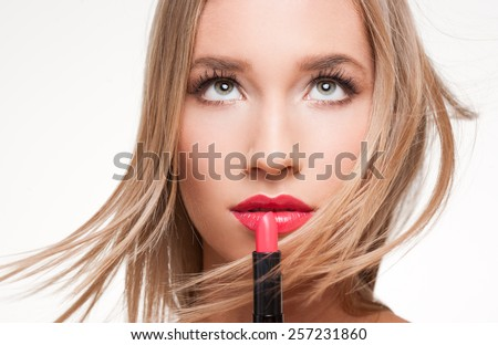 Portrait of a gorgeous blond in professional makeup.