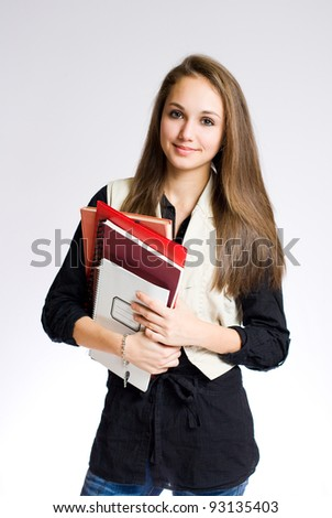 Portrait of a gorgeous brunette high school student girl. - stock photo