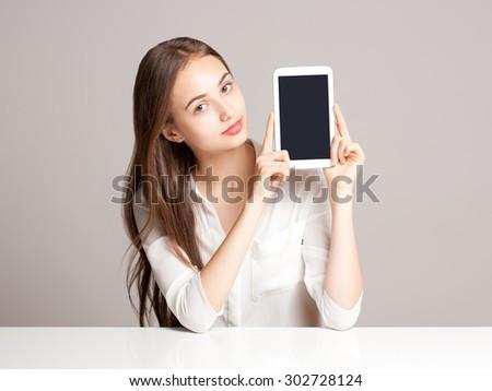 Portrait of a gorgeous brunette woman using tablet computer. - stock photo