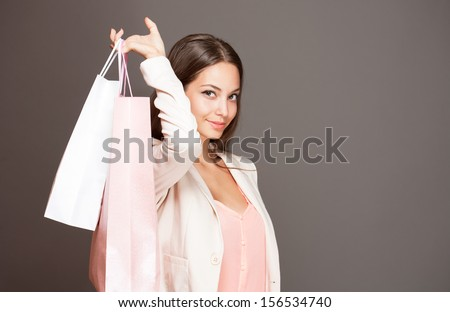 Portrait of a gorgeous fashionable young brunette shopper. - stock photo