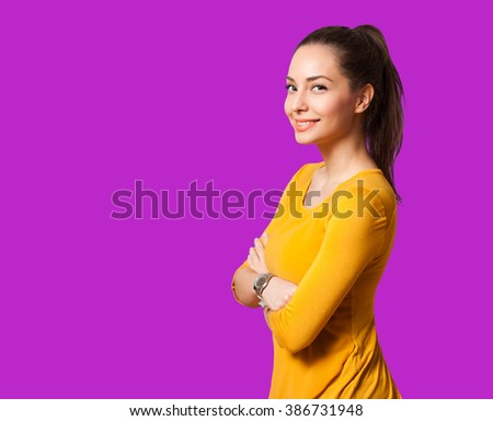 Portrait of a gorgeous happy brunette woman in very colorful setting. - stock photo