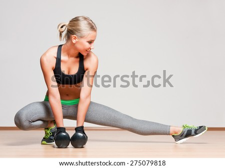 Portrait of a gorgeous young blond fitness woman. - stock photo