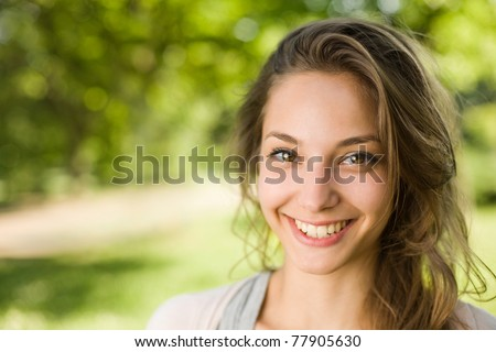 Portrait of a gorgeous young brunette girl in the park.