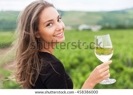 Portrait of a gorgeous young brunette woman having wine fun.