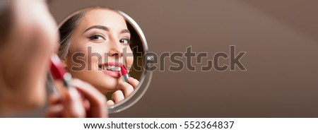 Portrait of a gorgeous young brunette woman in stylish makeup.