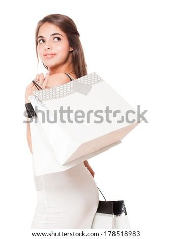 Portrait of a gorgeous young brunette woman with shopping bags.