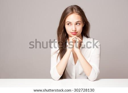 Portrait of a gorgeous young pensive brunette woman. - stock photo