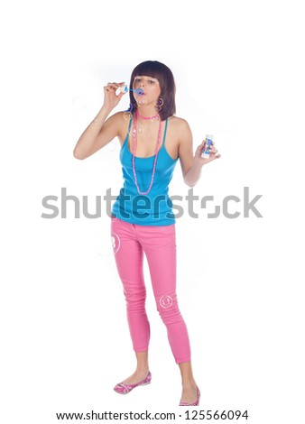 Portrait of a gorgeous young teen blowing soap bubbles. - stock photo