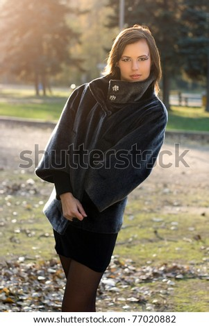 Portrait of a gorgeous young woman in autumn park