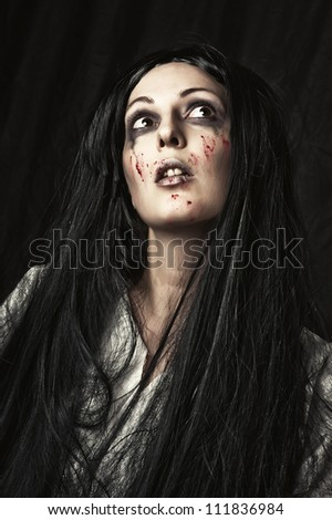 Portrait of a gory bloody and scary zombie - stock photo