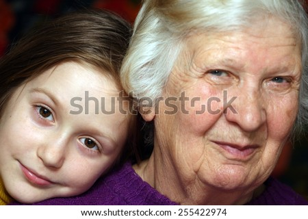 portrait of a grandmother and granddaughter, close-up