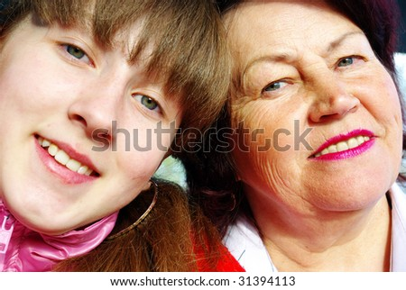 Portrait of a grandmother and her granddaughter