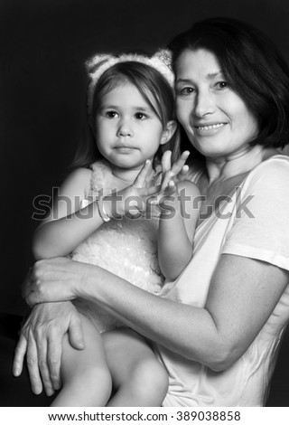 Portrait of a grandmother with her granddaughter - stock photo