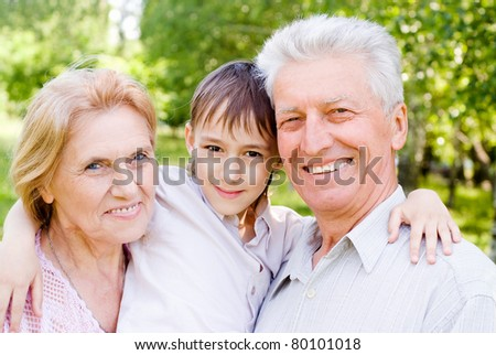 portrait of a grandson with his grandparents