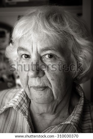 Portrait of a gray-haired elderly woman - stock photo