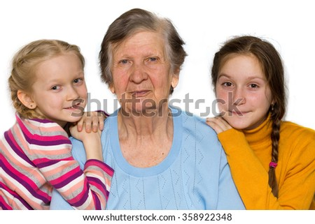 portrait of a great-grandmother, great-granddaughters, close-up - stock photo
