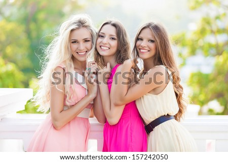 Portrait of a group of beautiful young female friends laughing - stock photo