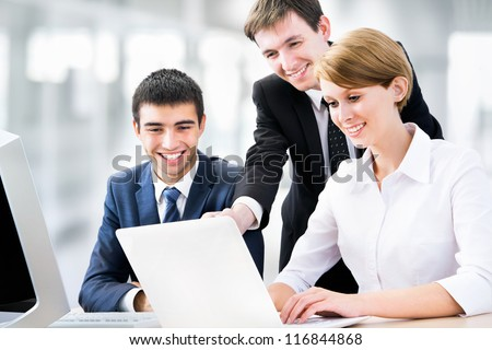 Portrait of a group of business people working together at a meeting - stock photo
