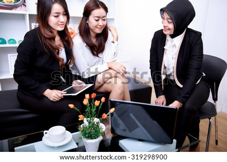 portrait of a group of businesswomen meeting at office living room