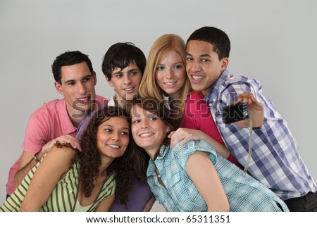 Portrait of a group of friends taking pictures