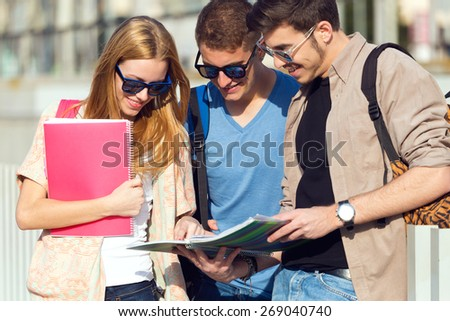 Portrait of a group of friends talking in the street after class. - stock photo
