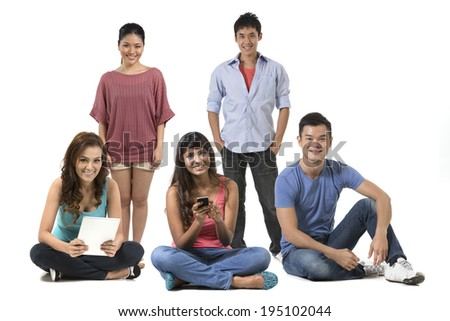Portrait of a group of Happy Asian people in there 20's. Isolated over white background - stock photo