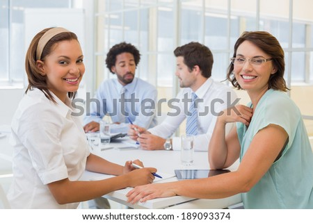 Portrait of a group of happy business people in meeting at the office