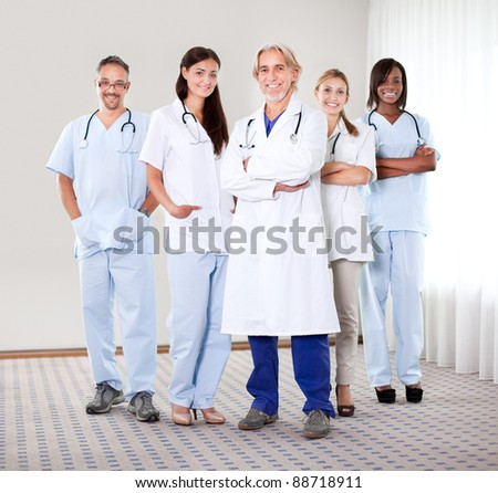 Portrait of a group of mature doctors standing together at the hospital