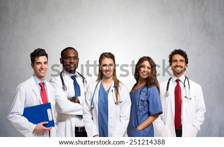 Portrait of a group of smiling doctors - stock photo