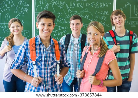 Portrait of a group of students at the school board background - stock photo